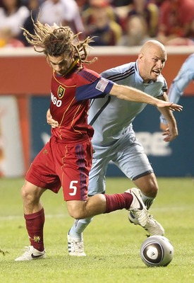 Real Salt Lake's Kyle Beckerman (left) and Colorado's Conor Casey battle for the ball