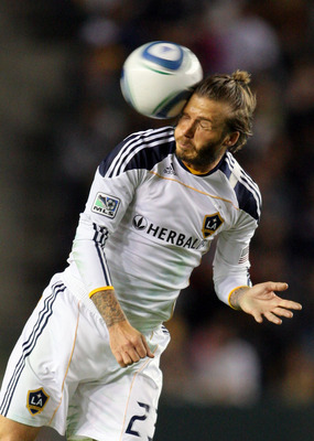 CARSON, CA - NOVEMBER 14:  David Beckham #23 of the Los Angeles Galaxy heads the ball in the second half during the Western Conference Finals match of the MLS playoffs against FC Dallas at The Home Depot Center on November 14, 2010 in Carson, California.