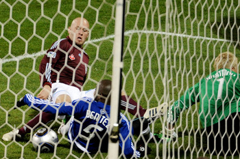 TORONTO, ON - NOVEMBER 21:  Conor Casey #9 of the Colorado Rapids scores against Jair Benitez #5 and Kevin Hartman #1 of FC Dallas during the second half of the 2010 MLS Cup match at BMO Field on November 21, 2010 in Toronto, Canada.  (Photo by Harry How/