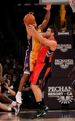 LOS ANGELES - NOVEMBER 5:  Derek Fisher #2 of the Los Angeles Lakers strips the ball from Andrea Bargnani #7 of the Toronto Raptors at Staples Center on November 5, 2010 in Los Angeles, California.  The Lakers won 108-102.   NOTE TO USER: User expressly a