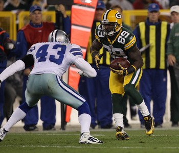 GREEN BAY, WI - NOVEMBER 07: James Jones #89 of the Green Bay Packers runs after a catch as Gerald Sensabaugh #43 of the Dallas Cowboys moves in for the tackle attempt at Lambeau Field on November 7, 2010 in Green Bay, Wisconsin. The Packers defeated the
