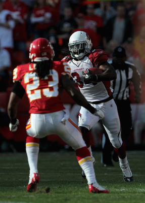 KANSAS CITY, MO - NOVEMBER 21:  Tim Hightower #34 of the Arizona Cardinals carries the ball as Kendrick Lewis #23 of the Kansas City Chiefs defends during the game on November 21, 2010 at Arrowhead Stadium in Kansas City, Missouri.  (Photo by Jamie Squire