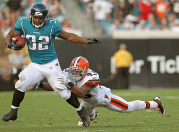 JACKSONVILLE, FL - NOVEMBER 21:  Maurice Jones-Drew #32 of the Jacksonville Jaguars is chased down by T.J. Ward #43 during a game agaisnt the Cleveland Browns at EverBank Field on November 21, 2010 in Jacksonville, Florida.  (Photo by Mike Ehrmann/Getty I