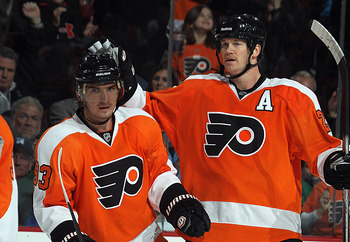 PHILADELPHIA - NOVEMBER 18: Nikolay Zherdev #93 and Chris Pronger #20 of the Philadelphia Flyers celebrate a goal against the Tampa Bay Lightning at the Wells Fargo Center on November 18, 2010 in Philadelphia, Pennsylvania. The Lightning defeated the Flye