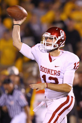 COLUMBIA, MO - OCTOBER 23: Landry Jones #12 of the Oklahoma Sooners passes against the Missouri Tigers at Faurot Field/Memorial Stadium on October 23, 2010 in Columbia, Missouri.  (Photo by Dilip Vishwanat/Getty Images)