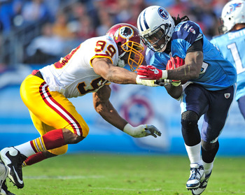 NASHVILLE, TN - NOVEMBER 21:  Andre Carter #99 of the Washington Redskins tackles Chris Johnson #28 of the Tennessee Titans at LP Field on November 21, 2010 in Nashville, Tennessee. The Redskins won 19-16 in overtime.  (Photo by Grant Halverson/Getty Imag
