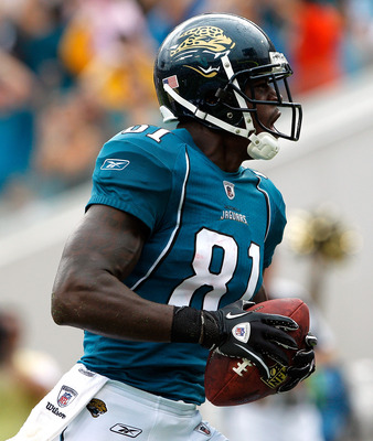 JACKSONVILLE, FL - SEPTEMBER 12:  Kassim Osgood #81 of the Jacksonville Jaguars celebrates a touchdown reception during the NFL season opener game against the Denver Broncos at EverBank Field on September 12, 2010 in Jacksonville, Florida.  (Photo by Sam