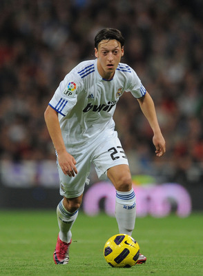 MADRID, SPAIN - NOVEMBER 07:  Mesut Ozil of Real Madrid in action during the La Liga match between Real Madrid and Atletico Madrid at Estadio Santiago Bernabeu on November 7, 2010 in Madrid, Spain.  (Photo by Denis Doyle/Getty Images)