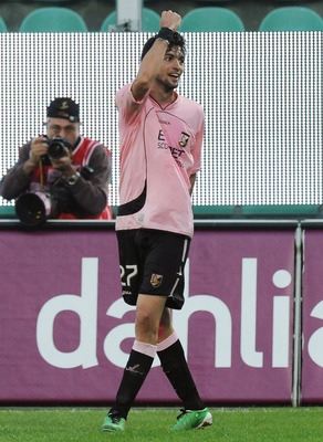 PALERMO, ITALY - NOVEMBER 14: Javier Pastore of Palermo celebrates after scoring the 3-1 goal, his third, during the Serie A match between Palermo and Catania at Stadio Renzo Barbera on November 14, 2010 in Palermo, Italy.  (Photo by Tullio M. Puglia/Gett