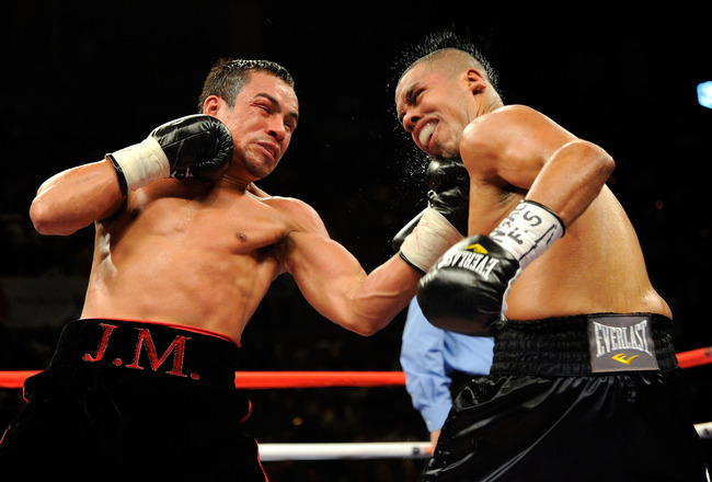 LAS VEGAS - JULY 31:  WBA/WBO lightweight champion Juan Manuel Marquez (L) hits Juan Diaz in the fourth round of their bout at the Mandalay Bay Events Center July 31, 2010 in Las Vegas, Nevada. Marquez retained his WBA and WBO lightweight championship bel