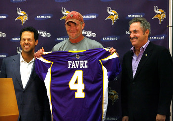EDEN PRAIRIE, MN - AUGUST 18: Brett Favre (C), Mark Wilf (L) and Zygi Wilf show the media Favre's Minnesota Vikings jersey on August 18, 2009 at Winter Park in Eden Prairie, Minnesota. (Photo by Scott A. Schneider/Getty Images)
