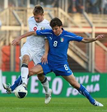 RIETI, ITALY - OCTOBER 08:  Andrea Poli (R) of Italy competes for the ball with  Maksim Skavish of Belarus during the Uefa U21 Championship play-off match between Italy and Belarus at Stadio Centro d'Italia - Manlio Scopigno on October 8, 2010 in Rieti, I