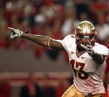 RALEIGH, NC - OCTOBER 28:  Timothy Orange #13 of the Florida State Seminoles celebrates after the defense recovered a fumble as Russell Wilson #16 of the North Carolina State Wolfpack walks off the field during their game at Carter-Finley Stadium on Octob