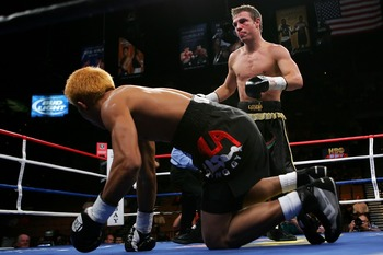 LAS VEGAS - JULY 21:  Michael Katsidis of Australia knocks down Czar Amonsot of the Philippines during their WBO interim lightweight championship fight at the Mandalay Bay Events Center July 21, 2007 in Las Vegas, Nevada.  (Photo by Ethan Miller/Getty Ima