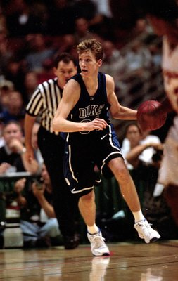 27 Nov 1999:  Mike Dunleavy, Jr. #34 of the Duke Blue Devils dribbles the ball against the USC Trojans during the Wooden Classic at the Arrowhead Pond in Anaheim, California. The Blue Devils defeated the Trojans 81-68. Mandatory Credit: Tom Hauck/Allsport