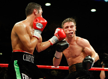 LAS VEGAS - SEPTEMBER 19:  Vincent Escobedo (L) hits Michael Katsidis in the seventh round of their WBO interim lightweight title fight at the MGM Grand Garden Arena September 19, 2009 in Las Vegas, Nevada. Katsidis won the title by split decision.  (Phot