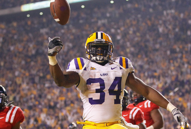 BATON ROUGE, LA - NOVEMBER 20:  Stevan Ridley #34 of the Louisiana State University Tigers reacts after scoring the go-ahead toucdown in the final minutes of the fourth quarter against the Ole Miss Rebels at Tiger Stadium on November 20, 2010 in Baton Rou