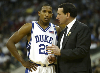 RALEIGH, NC - MARCH 20:  Head coach Mike Krzyzewski and Chris Duhon #21 of the Duke Blue Devils talk during the second round game of the NCAA Division I Men's Basketball Tournament against the Seton Hall Pirates on March 20, 2004 at RBC Center in Raleigh,