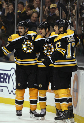 BOSTON - NOVEMBER 18:  Milan Lucic #17 of the Boston Bruins is congratulated by teammates Nathan Horton #18 and Patrice Bergeron #37 after Lucic scored his second goal against the Florida Panther on November 18, 2010 at the TD Garden in Boston, Massachuse