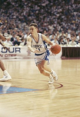 6 Apr 1992:  Guard Bobby Hurley of the Duke Blue Devils dribbles the ball down the court during a playoff game against the Michigan Wolverines at the Hubert H. Humphrey Metrodome in Minneapolis, Minnesota.  Duke won the game 71-51. Mandatory Credit: Jonat