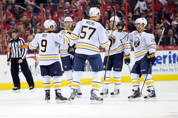 WASHINGTON - NOVEMBER 17:  Derek Roy  #9 of the Buffalo Sabres celebrates with teammates after scoring in the second period against the Washington Capitals at the Verizon Center on November 17, 2010 in Washington DC.  (Photo by Greg Fiume/Getty Images)