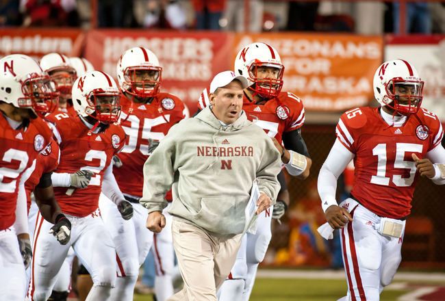 LINCOLN, NE - NOVEMBER 13: Coach Bo Pelini of the Nebraska Cornhuskers leads his team onto the field to play the Kansas Jayhawks at Memorial Stadium on November 13, 2010 in Lincoln, Nebraska. Nebraska Defeated Kansas 20-3. (Photo by Eric Francis/Getty Ima
