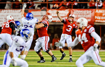 LINCOLN, NE - NOVEMBER 13: Taylor Martinez #3 of the Nebraska Cornhuskers throws downfield against the Kansas Jayhawks during their game at Memorial Stadium on November 13, 2010 in Lincoln, Nebraska. Nebraska Defeated Kansas 20-3. (Photo by Eric Francis/G