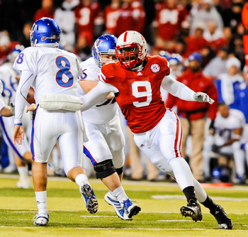 LINCOLN, NE - NOVEMBER 13: Joe Broekemeier #9 of the Nebraska Cornhuskers takes aim on Quinn Mecham #8 of the Kansas Jayhawks during their game at Memorial Stadium on November 13, 2010 in Lincoln, Nebraska. Nebraska Defeated Kansas 20-3. (Photo by Eric Fr