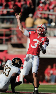 LINCOLN, NE - OCTOBER 30: Quarterback Taylor Martinez #3 of the Nebraska Cornhuskers throw downfield during first half action of their game at Memorial Stadium on October 30, 2010 in Lincoln, Nebraska. Nebraska Defeated Missouri 31-17. (Photo by Eric Fran
