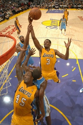 Ebanks (3) soars from rebound even over Caracter (45)