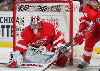 DETROIT, MI - NOVEMBER 19:  Jimmy Howard #35 of the Detroit Red Wings eyes a puck he is about to stop in a game against the Minnesota Wild on November 19, 2010 at the Joe Louis Arena in Detroit, Michigan. (Photo by Claus Andersen/Getty Images)