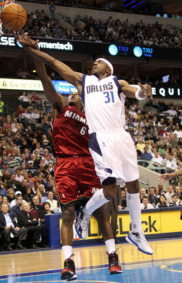 DALLAS - FEBRUARY 20:  Guard Jason Terry #31 of the Dallas Mavericks takes a shot against Mario Chalmers #6 of the Miami Heat on February 20, 2010 at American Airlines Center in Dallas, Texas.  NOTE TO USER: User expressly acknowledges and agrees that, by