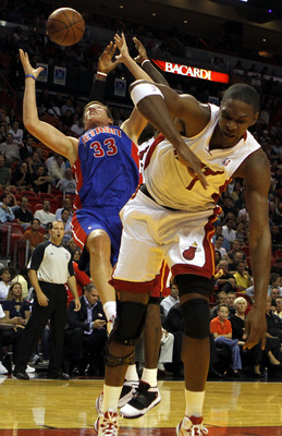 MIAMI - OCTOBER 05:  Center Chris Bosh #1 of the Miami Heat (L) battles Forward Jonas Jerebko #33 of the Detroit Pistons on October 5, 2010 in Miami, Florida.  NOTE TO USER: User expressly acknowledges and agrees that, by downloading and or using this pho