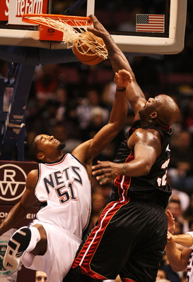 EAST RUTHERFORD, NJ - NOVEMBER 17:  Shaquille O'Neal #32 of the Miami Heat dunks the ball against Sean Williams #51 of the new Jersey Nets  during their game on November 17, 2007 at the Izod Arena in East Rutherford, New Jersey.  (Photo by Al Bello/Getty