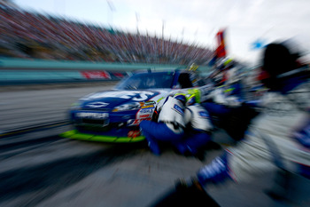 HOMESTEAD, FL - NOVEMBER 21:  Jimmie Johnson, driver of the #48 Lowe's Chevrolet, pits during the NASCAR Sprint Cup Series Ford 400 at Homestead-Miami Speedway on November 21, 2010 in Homestead, Florida.  (Photo by Jason Smith/Getty Images for NASCAR)