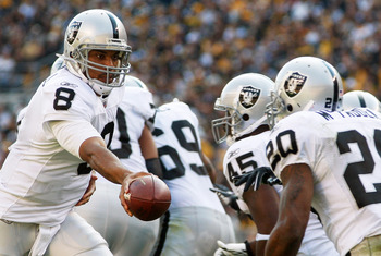 PITTSBURGH - NOVEMBER 21:  Jason Campbell #8 of the Oakland Raiders hands the ball off to teammate Darren McFadden #20 during the game against the Pittsburgh Steelers on November 21, 2010 at Heinz Field in Pittsburgh, Pennsylvania.  (Photo by Jared Wicker