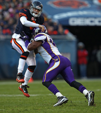 CHICAGO - NOVEMBER 14: Jay Cutler #6 of the Chicago Bears is hit after throwing a pass by Everson Griffen #97 of the Minnesota Vikings at Soldier Field on November 14, 2010 in Chicago, Illinois. The Bears defeated the Vikings 27-13. (Photo by Jonathan Dan