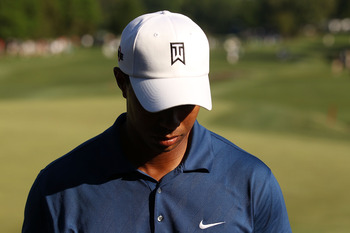 CHARLOTTE, NC - APRIL 30:  Tiger Woods finishes his round and failed to make the cut during the second round of the Quail Hollow Championship at Quail Hollow Country Club on April 30, 2010 in Charlotte, North Carolina.  (Photo by Streeter Lecka/Getty Imag
