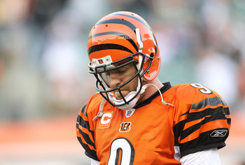 CINCINNATI - NOVEMBER 21:  Carson Palmer #9 of the Cincinnati Bengals walks off of the field after throwing an interception late in the fourth quarter of the Bengals 49-31 loss to the Buffalo Bills at Paul Brown Stadium on November 21, 2010 in Cincinnati,