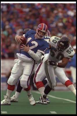 28 Dec 1996:  Linebacker Eddie Robinson of the Jacksonville Jaguars tackles Buffalo Bills quarterback Jim Kelly during a playoff game at Rich Stadium in Orchard Park, New York.  The Jaguars won the game, 30-27. Mandatory Credit: Rick Stewart  /Allsport