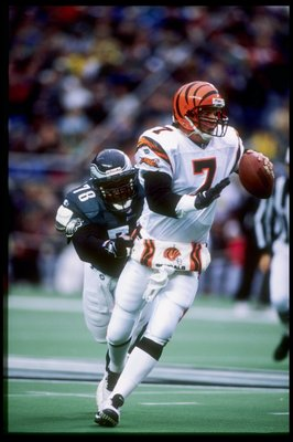 30 Nov 1997:  Quarterback Boomer Esiason of the Cincinnati Bengals tries to get away from defensive tackle Hollis Thomas of the Philadelphia Eagles during a game at Veterans Stadium in Philadelphia, Pennsylvania.  The Eagles won the game 44-42. Mandatory