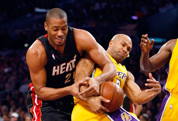 LOS ANGELES, CA - DECEMBER 04:  Jamaal Magloire #21 of the Miami Heat and Derek Fisher #2 of the Los Angeles Lakers fight for a rebound in the first half at Staples Center on December 4, 2009 in Los Angeles, California. NOTE TO USER: User expressly acknow