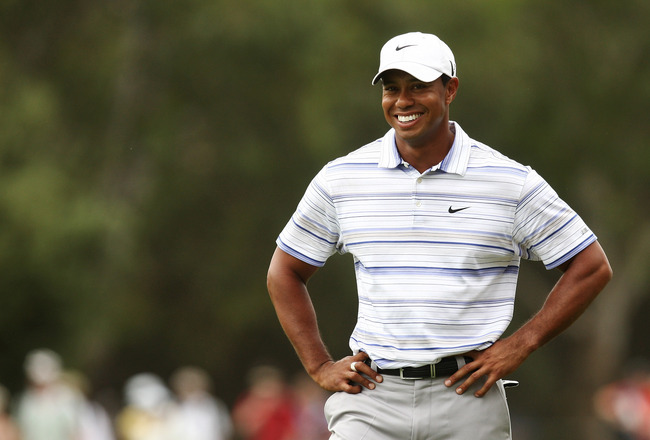 MELBOURNE, AUSTRALIA - NOVEMBER 14:  Tiger Woods of the USA smiles whilst preparing to play an approach on the 14th hole during round three of the 2009 Australian Masters at Kingston Heath Golf Club on November 14, 2009 in Melbourne, Australia.  (Photo by
