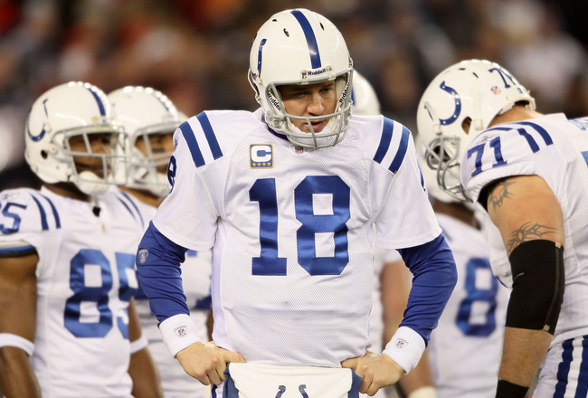 FOXBORO, MA - NOVEMBER 21:  Peyton Manning #18 of the Indianapolis Colts looks on during a time out in the second half against the New England Patriots on November 21, 2010 at Gillette Stadium in Foxboro, Massachusetts. The Patriots defeated the Colts 31-