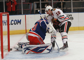 NEW YORK - NOVEMBER 01: Patrick Sharp #10 of the Chicago Blackhawks is stopped by Henrik Lundqvist #30 of the New York Rangers at Madison Square Garden on November 1, 2010 in New York City.  (Photo by Bruce Bennett/Getty Images)