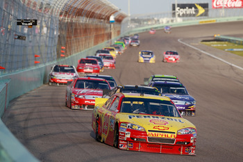 HOMESTEAD, FL - NOVEMBER 21:  Kevin Harvick, driver of the #29 Shell/Pennzoil Chevrolet, leads a line of cars during the NASCAR Sprint Cup Series Ford 400 at Homestead-Miami Speedway on November 21, 2010 in Homestead, Florida.  (Photo by Chris Graythen/Ge