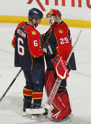 SUNRISE, FL - NOVEMBER 10: Goaltender Tomas Vokoun #29 of the Florida Panthers is congratulated by teammate Dennis Wideman #6 after defeating the Toronto Maple Leafs 4-1 on November 10, 2010 at the BankAtlantic Center in Sunrise, Florida. (Photo by Joel A