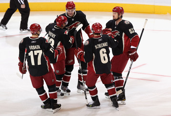 GLENDALE, AZ - NOVEMBER 23:  Martin Hanzal #11 of the Phoenix Coyotes celebrates with teammates after Hanzal scored a first period goal against the Edmonton Oilers during the NHL game at Jobing.com Arena on November 23, 2010 in Glendale, Arizona.  (Photo