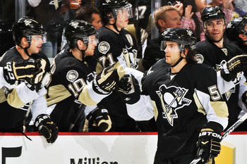 PITTSBURGH - NOVEMBER 19:  Kris Letang #58 of the Pittsburgh Penguins is congratulated by the bench after scoring a shoot out goal against the Carolina Hurricanes on November 19, 2010 at Consol Energy Center in Pittsburgh, Pennsylvania.  (Photo by Jamie S