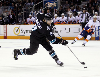 SAN JOSE, CA - NOVEMBER 11:  Joe Pavelski #8 of the San Jose Sharks puts a shot on goal during their game against the New York Islanders on November 11, 2010 in San Jose, California.  (Photo by Ezra Shaw/Getty Images)